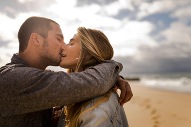 hot kiss on the beach photo