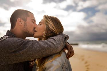 hot kiss on the beach photo